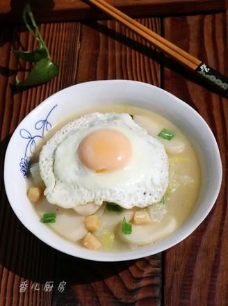 太阳蛋白菜干贝年糕汤的做法